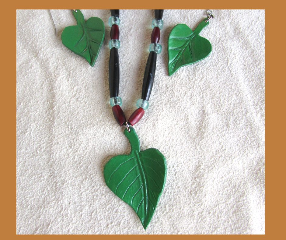 Leather Catalpa Leaf Set includes a hand painted 3 leaf necklace, earrings and a stick barrette.