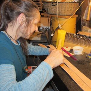 How the hand tooled designs are created on a leather belt.