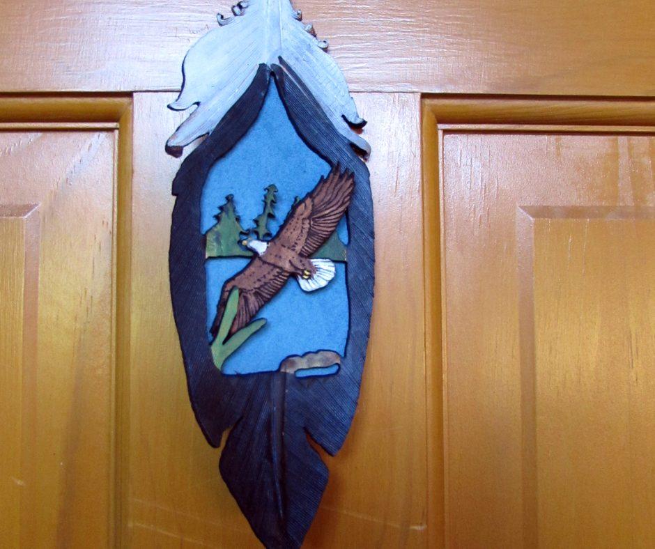 Handmade Leather Feather Eagle Ornament Eagle soaringover lake.